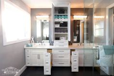 Custom his and her vanities with a storage tower.