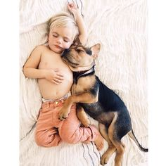 Don't think there's anything more adorable than a child and dog napping together....