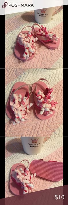 """Mudpie Baby Girl Adorable Sandals 💕 Mud Pie baby girl Sandals.  Bought as a decoration for my daughter's baby shower.  New without tags.  Pink base with pink polka dot ribbon across the foot, and spiral ribbons 🎀 decorate the front.  Very unique and """"girlie"""" 💕. Size is 4"""", close to a size 1 for Baby. Mud Pie Shoes Sandals & Flip Flops"""