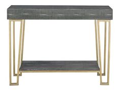 Hand-wrapped faux Black Shagreen, scaffolded by an architectural Antique Brass base, affords the handsome Marlowe Console Table singular texture and quality.