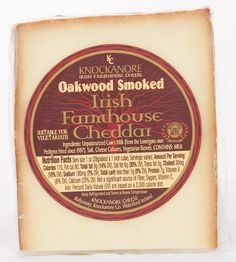 Knockanore- This delicious oak smoked semi-firm cheese is made using a blend of oak hardwood in a traditional smoking kiln locally sourced in Knockanore's neighboring Irish heritage town of Lismore. Smoke circulates around the cheese, giving it an aromatic flavor.