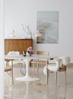 Casual organic modern dining room with sea theme art and natural color palette. I'm going for a slightly moodier, more glam version of this in my dining room.