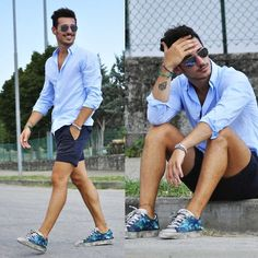 Pairing a baby blue button-down shirt with navy shorts is a comfortable option for running errands in the city. This outfit is complemented perfectly with blue floral low top sneakers.   Shop this look on Lookastic: https://lookastic.com/men/looks/long-sleeve-shirt-shorts-low-top-sneakers/11932   — Navy Sunglasses  — Light Blue Long Sleeve Shirt  — Green Bracelet  — Navy Shorts  — Blue Floral Low Top Sneakers  — No Show Socks