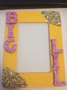 The frame I made for my big, that I gave to her with the paddle I made for her!!!