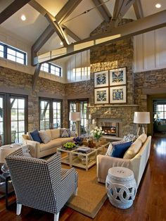 Family room / living room / den interior design ideas and home decor with beamed ceiling by HGTV Dream Home
