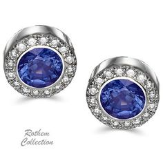 SKU: REBSw Impressive white gold blue sapphire halo earrings with diamonds, feature bezel setting of blue sapphire gemstones, complemented by round diamonds.