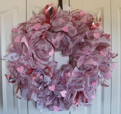A personal favorite from my Etsy shop https://www.etsy.com/listing/262414487/deco-mesh-pink-heart-wreath-pink-and