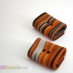 kato polymer clay drawer pulls  | Friday, November 27, 2009   ..................   knobs shaped like with twine and disc or tube  ........could use strips of birch..........