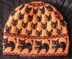 Free Knit Cat Hat Pattern. Not orange and black, but maybe like dark grey and white...