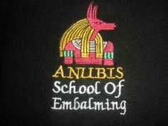 """ANUBIS – SCHOOL OF EMBALMING"" POLO SHIRT. Black, embroidered polo shirt. Embroidered Polo Shirts, Anubis, Christmas Ornaments, Sweatshirts, School, Black, Black People, Christmas Jewelry, Trainers"