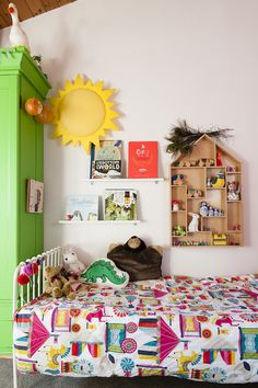 Esther's room is fun and colourful; the wardrobe has been revamped with a bright pea green paint, and her books are displayed on flating shelves. #WTinteriors