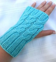 Knitting Pattern for Easy Three Cable Hand Warmers - These fingerless mitts are kniton straight needles and seamed. Rated easy by Ravelrers. Two sizesMedium/Large (X-Large). Pictured project by KimH.
