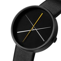 "Crossover Watch is a contemporary design modeled after the game ""pick up stix"".  Its elegant hands, that appear to be precariously balanced, rotate around the dial. Crossover is a modern watch with tapered white, gray and yellow hands. The second hand is yellow, the minute hand is white and the hour hand is gray. 
