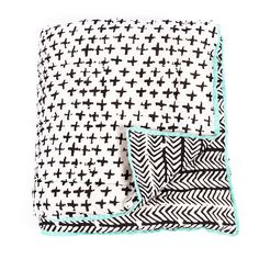 ARRO Home: Reversible cotton single quilt with wadding.   Painted Crosses with Painted Chevron on reverse. Black design on white base with contrasting green piping border.   Dimensions: 140cm X 210cm.
