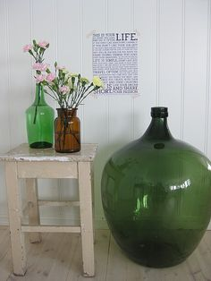 Large green demijohn bottle