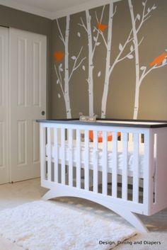 modern nursery, orange accents, orange and gray, bird themed nursery, white nursery furniture, trees