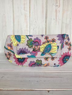 A personal favourite from my Etsy shop https://www.etsy.com/uk/listing/290964511/clutch-bagfloral-clutch-baghandmade
