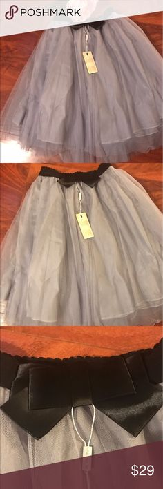 NWT Grey Tulle Midi Skirt with 🎀 Bow Accent Adorable Tulle Midi Skirt with accent bow and elastic waist is perfect for those ballerina twirls we all love so much! Elastic waist allows Skirt to fit almost all sizes! Dress it down with a chambray top or Graphic Tee for weekend errands or dress it up with heels and a glam top for a fun night out! Never worn, smoke free home. Skirts A-Line or Full