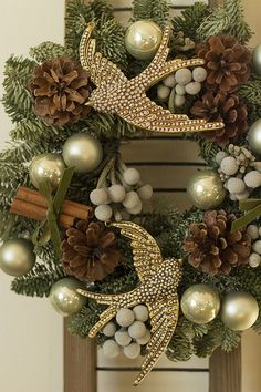 Very easy to make...wait until afer Christmas when all Christmas items are 80% off, yes that is right...80% off. buy the small wreaths at the dollor store, make them into one larger or get a plain one at Michaels and start by adding your ribbon or burlap first then adding your like orwhat goes with your theme.