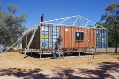 our shipping container house has been prefabbed at home and relocated to be rebuilt - adding the web trusses to the roof.