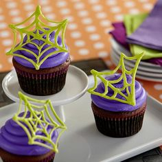 spider web cupcakes these vivid candy spider webs are piped freehand using wilton vibrant green candy melts candy use them to top cupcakes or add to the
