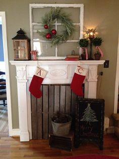 Christmas mantle - love the window & wreath