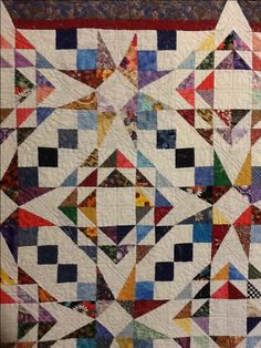 """54-40 or Fight"" and ""Corn and Beans"" both are available from quilters cache for free. The color placement and values makes sewcrazy12's scrappy quilt a beauty."