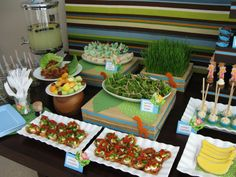 This is a jungle party-but I like the food & their names for a luau-served on paper leaves; banana shaped cookies; coconut creamies; tropical fruit; lettuce wraps; ...be creative!