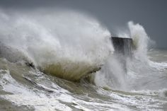 Waves crash into the breakwater in Newhaven, East Sussex