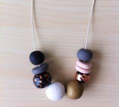Georgina - Handmade Polymer clay Necklace, 9 bead, adjustable cream waxed cotton cord
