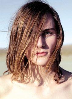 Smooth amber hair, icy blue-grey eyes.