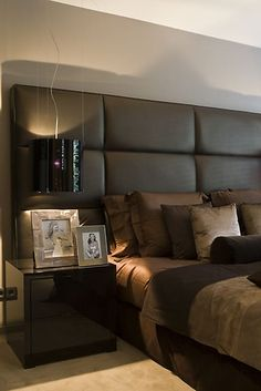 oversized headboard - love the fabric panels. very masculine but soft.