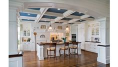 This ceiling would be great in a large kitchen. I would skip the blue and go with all white. This would be a cool glass ceiling...but not very practical.