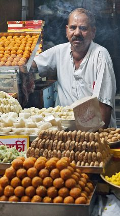 the sweet  seller, Night time market near a Hindu shrine in central Delhi, India