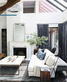 via Rue // Catherine Kwong Designs // salvaged wood coffee table // roll arm sofa // these lamps! http://thayermanor.wordpress.com/