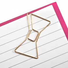 Keep important papers and documents tidy with pretty Kate Spade gold bow paper clips