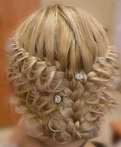 intricate wedding hair, do three lace braids on each side of the head and pull out the lower strands and combine the braids and make a bun