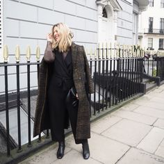 Erica Davies from the-edited.com wearing #Jigsaw coat, #Zara jumpsuit, #DuneBlack boots and #AnyaHindmarch smiley bag