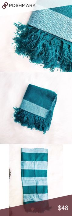 """Teal Fringed Ethically Made Scarf SoloHope creates ethical and sustainable products by employing and empowering individuals and communities. This hand-loomed scarf is a gorgeous teal green with thick white stripes and fringe at the ends.  L: 70"""" W: 28""""  ✅Bundle & Save 🚫Trades 🚫Off-Posh 🚫Modeling  ✔️All measurements are closest approximation.✔️  💞Shop with ease; I'm a Posh Ambassador.💞  A1-15 SoloHope Accessories Scarves & Wraps"""
