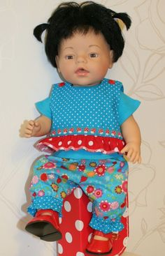 Baby Born doll in turquoise outfit