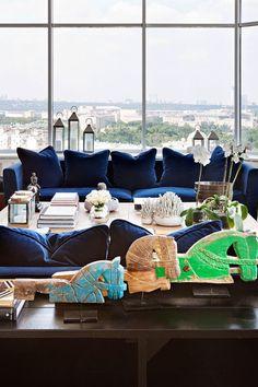 Blue-velvet-sofa-home-of-designer-Ksenia Nikitina