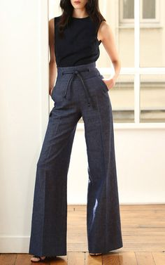 The Paris-based Australian designer strikes a balance between nonchalance and perfectionism in typically luxurious fashion this season. These **Martin Grant** pants exude modern sophistication in a wed legged silhouette, denim fabrication and leather tie embellishment at the waist.