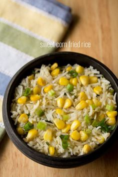 sweet corn fried rice recipe made easy with step by step pics. homely, simple and delicious fried rice made with sweet corn, spring onions, capsicum and herbs+spices.