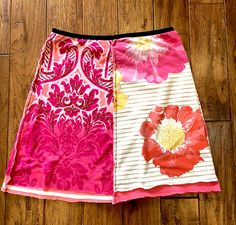 Romantic upcycled t-shirt skirt made from new and repurposed t-shirts and cotton jersey. Great skirt to pair with your boots or flip flops for a summer lunch. This would also make a beautiful skirt for a beach wedding. Eco friendly, unique, quality upcycled clothing......Everyday upcycled summer tshirt skirt that is great for everyday! I have 50+ years of experience in garment construction and I take great pride in my creations! This skirt has two separate layers cut in different lengths…