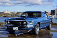 1969 FORD MUSTANG MACH 1 428 CJ FASTBACK This is a completely restored, matching numbers, 1969 Ford Mustang Mach 1 428-4V V8 Cobra Jet with 335hp and 440ft/lbs of torque. It is in its original color combination of Winter Blue with a blackout hood, with black Clarion knit/vinyl Mach 1 hi-back bucket seats. It came factory equipped with a 4-speed close ratio manual and 3.50 rear axle ratio