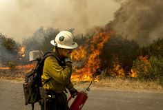 Forest Service firefighter moves away from a quickly moving section of the Rim Fire in the Stanislaus National Forest in California, Tuesday August (Andy Alfaro/Modesto Bee) Yosemite National Park, National Parks, National Forest, Wildland Firefighter, Into The Fire, Forest Service, Fire Dept, Fire Trucks, Bradley Mountain