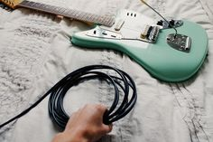 """Electric guitars come in many different shapes. Single neck, double neck, double neck in opposite ways, minimalistic, flamboyant, etc. However, there are some """"basic rules"""" for the way they look. For example, a guitar has a fretboard and a body. If you change that configuration one could argue it's not a guitar anymore but a ... Read more Why Are Electric Guitars Shaped The Way They Are 👈 Tommy Emmanuel, Chet Atkins, Types Of Guitar, Guitar Cable, Fingerstyle Guitar, Cool Electric Guitars, Guitar Tips, Classical Guitar, Cool Guitar"""