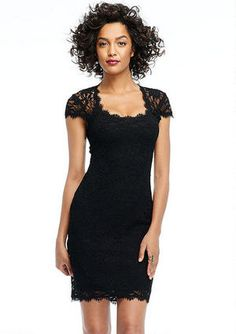 Lace cap-sleeve dress with eyelash trim detail. Cutout detail in back. Button closure at neck. Bra friendly; fully lined.