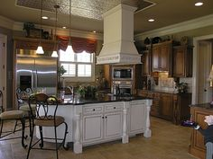 European Kitchen spotlights light and dark cabinetry in Plan 129S-0006 | House Plans and More