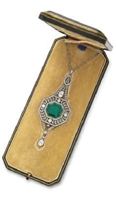 A BELLE EPOQUE EMERALD AND DIAMOND PENDANT NECKLACE  Centering upon a bezel-set…